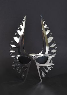 LEGION – fly towards ultra-style. LEGION is a product of the extreme, half way between a mask and sunglasses, destined to embody the Parasite spirit, it takes references from a mix of ancient cultures (Egyptian, Mayan, Indian, and Roman) and utilizes high tech materials which results in a futuristic and mythological appearance. LEGION is a collector's item or the ultimate fashion accessory, it caters to the passionate and enlightened visionaries – for the prophets of the Parasite brand.