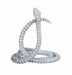 This extra-long diamond and white gold Bulgari Serpenti High Jewelry  Collection snake necklace was made to wrap twice around the throat.