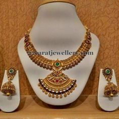 Jewellery Designs: Antique Necklace with Jhumkas