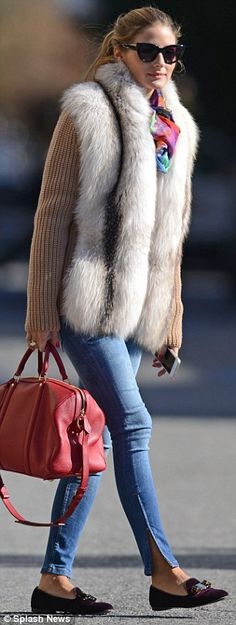 Always ready for her close-up: Earlier that day, the star was equally stylish as she headed out in Brooklyn dressed in jeans, purple loafers, a brightly patterned scarf, standout fur jumper and a bright red handbag