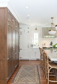 Mixed finishes - white, wood, grey. Antique brass. Cabinets scale right up to the ceiling.  -- Franklin « KitchenLab Design