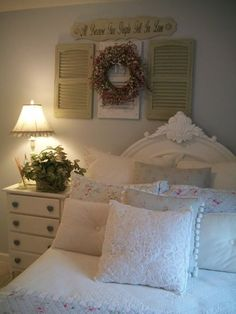 Above the bed decor - center over headboard...paint shutters to match room colors.