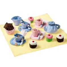 Tea Set with Cupcakes  38.50 €     No more broken plates with this lovely tea set by Oskar & Ellen! A beautiful mix of colours makes this tea set perfect for girls and boys to play Tea Party or Picnic in the park. This handmade set includes: four cups, saucers and teaspoons, a tea pot, sugar bowl, tea bags, picnic blanket and delicious cupcakes and biscuits. In total 32 pcs.    Made out of 35% cotton and 65% polyester. Hand wash at 40 degrees.