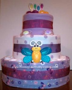 Homemade Baby Girl Diaper Cake... This website is the Pinterest of diaper cake ideas