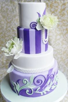 Purple contemporary 4 round tiers of uneven height.