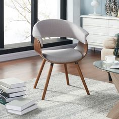 Features: -Curved bentwood frame in a walnut finish. -Gray fabric back and seat cushion with piping detail. -Mid-century modern styling. -Solid rubberwood legs in a walnut finish. Frame Finish: -