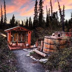 Alaska Glamping experience with Glacier views. Comfortable beds with private luxury tents and a wood burning hot tub to soak in at night.