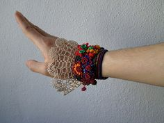 freeform crochet bracelet with colorful beaded flowers and cream crochet lace | Flickr - Photo Sharing!
