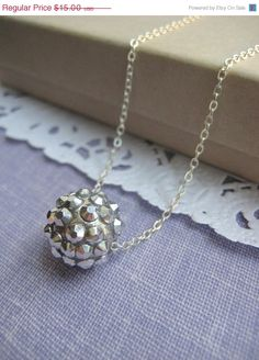 Shiny silver bead necklace. Other colours available.. $15.00, via Etsy.