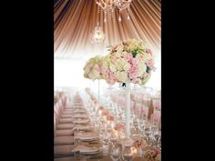 Gorgeous idea for flowers at a wedding. Gives height to the venue and is so elegant!
