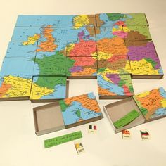 Learning geography the fun way: we made a puzzle with match boxes. We put flags and curiosities of each country inside them.