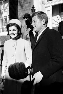 Jack and Jackie Kennedy emerge from their Georgetown home on Inauguration Day 1961, headed for the White House to join the Eisenhowers for the journey to Capitol Hill.