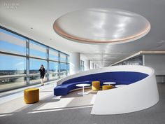 One Firm Masterminds 5 Projects For Hyundai  Solid-surface seating curves create ad hoc lounge areas at the corners of the workplace. Photography by Benny Chan/Fotoworks.