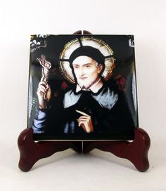 A new #catholic icon on tile dedicated to St Vincent De Pauli Now available on #Etsy https://www.etsy.com/listing/480872521