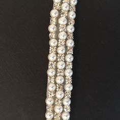 Crystal Rhinestone Embellished Trimming by the yard. DIY for bridal belts, hairbands, or other embellishments. Also perfect for adding some sparkle to dance costumes and ice skating dresses.  Trim is made with clear crystal rhinestones and pearls in a repeating pattern. Resin, iron on backing  * 0.75 Wide *  *** Crystal Trimmings & Appliques is a wholesale distributor of high-end bridal trim. Larger quantities are available by request, or custom orders are welcome. We try our best to make...