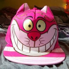 Cheshire cat hat Alice in wonderland Cheshire cat hat. Got it at Disneyland. I love this hat it's only used as decoration and when I go to Disneyland which is like once every so often. My dog hates this hat. She is always scared and barking at it. Don't wanna have to sell but will only sell to best offer. No lowballing. Nothing under 25$ disney Accessories Hats