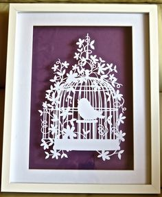 Another birdcage, template by Paper Panda hand cut by myself.  This time with mauve background.
