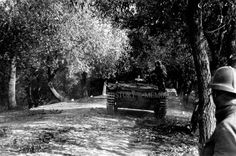 Rear view of the early Panzer III Ausf. E circa 1939. The man in the foreground is wearing a strange hat.