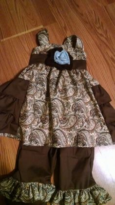 Size2 Toddler girl ruffle outfit.Brown/ blue paisley pattern with a crochet rose.   Made for my grand daughter.
