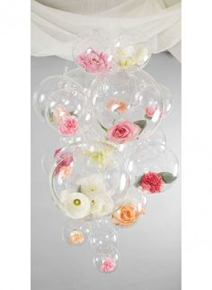 """This dramatic floral """"chandelier"""" encompasses hanging vases & terrariums with flowers resting inside. It is from 'Project Wedding' of five innovative design concepts for your wedding ceremony and reception decor. Chandelier Wedding Decor, Floral Chandelier, Balloon Display, Balloon Gift, Ball Decorations, Diy Wedding Decorations, Balloon Flowers, Diy Flowers, Hanging Vases"""