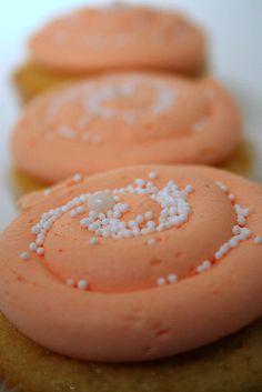 creamsicle cupcake    vanilla cupcake with orange buttercream, buttercream filling, sprinkles on top!