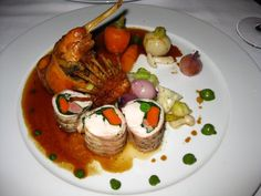 Trio of rabbit (loin, rack, and braised leg) with baby vegetables, roasted garlic, natural jus at La Folie