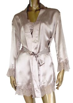 Silk nightgown with gorgeous stretch lace on the bottom and sleeves and a ribbon belt in the middle. This dress is elegant and luxurious and feels incredibly soft and sensual.