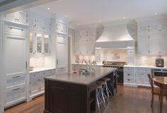 white kitchen, dark island, light floors