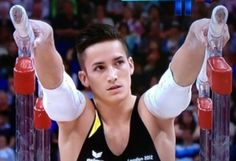 Marcel Nguyen - Olympic gymnast, silver medal. European+Vietnamese = *swoon*. I'll root for Germany just this once. ;)