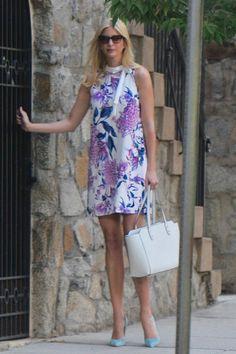 Ivanka Trump wearing Ivanka Trump Tribeca Solutions Satchel in Blush and Ivanka Trump Floral Sleeveless Scuba Crepe Mock Neck W/ Tie