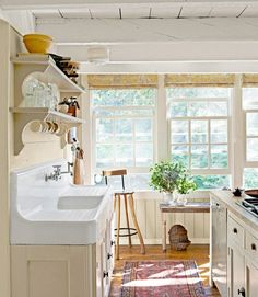 bright yellow kitchen, farmhouse drainboard sink