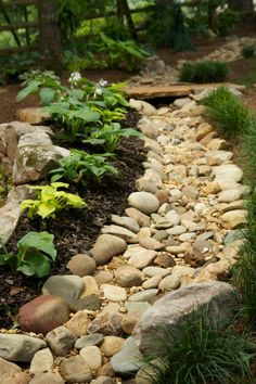 Love dry creek beds in kids play spaces. I like the bridge over this one.