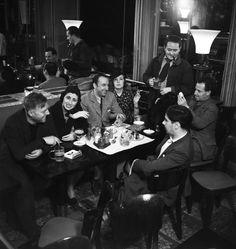 France. Emile Savitry, Paul Grimault, Amparo Mom, Pablo Neruda, Delia del Carri, Bar de la Coupole, Montparnasse, Paris, c.1939