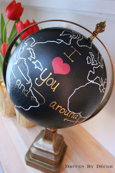 """An upcycled painted globe with the words """"I Love You Around the World and Back Again"""""""