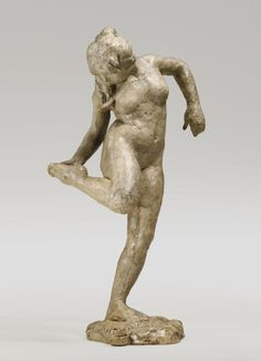 Edgar Degas, Dancer Looking Back at Her Foot, 1890. Plaster, 18.88 in. tall.