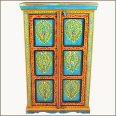 We bring the soothing pallet of blues, greens, and orange together to make a bright and playful Oklahoma Farmhouse Green & Blue Floral Wardrobe Cabinet.