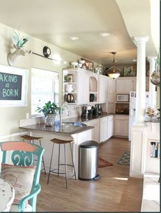 LOVE the way  she decorated the top of the cabinets