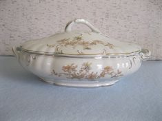 GW....$7...This antique transfer ware serving bowl has a light as a feather delicate floral design on the lid and on both sides of the bowl. Subtle shades of