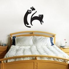 Cats on the wall. Combining with bed makes a lot more sense :)