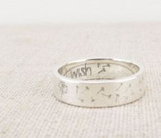 A beautiful ring to make a wish on! A little dandelion with it's fluffy seeds blowing away in the wind. I wish is inscribed inside though we can change the inscription to anything you would like! The