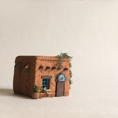 Adorable handmade adobe house by   Nicolas and Sofie via etsy.