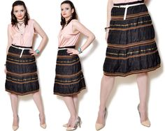 Vintage striped boho skirt. The model on the pictures is size S/36 and 165 cm height. Please check measurements with your own to avoid problems with the size. Make sure you double the measurements where shown (*2):  Label size: L/40 Total lenght: 64 cm / 25.25 inches Waist: 36.5 cm *2 / 14.25 inches *2 Hips: 48.5 cm *2 / 19.25 inches *2 open Bottom Width: 66 cm *2 / 25.5 inches *2 Condition: very good Colors: brown, gold, beige Circa: 90s Fabric: 42% Polyester, 3...