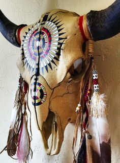 Black War Bonnet design, in acrylics. Dangles made from imitation eagle feathers. with peyote stitch beadwork, dyed horsehair, trade cloth, pony beads, hawk bells, rawhide, sinew and leather. By Ken Collier