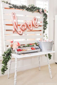 This charming party decor proves that nothing makes a better theme than love! Grab some copper mylar balloons to decorate the food and drink table of the bridal shower or baby shower you're hosting.