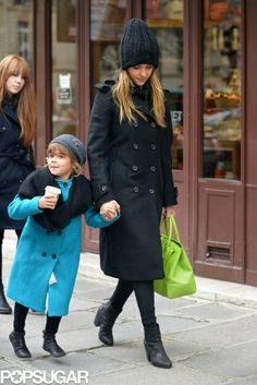 42 Unparalleled Street-Style Looks Courtesy of Jessica Alba: While vacationing in the City of Light, Jessica jazzed up her black-on-black combo — double-breasted coat and knit beanie — with a neon green tote and a pop of polka dots seen through her perforated Rag & Bone ankle boots.