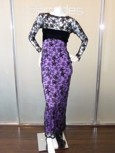 Yves Saint Laurent Haute Couture evening gown of Chantilly lace with delicate black paillette embroidery, violet silk charmeuse lining, and signature black velvet bow.
