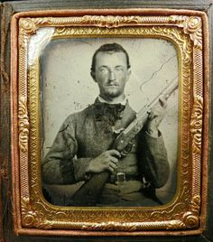 A sixth plate clear-glass ambrotype in a full homemade case. The image shows a rough and tough armed rebel ready for battle. The image has some scuffing etc.