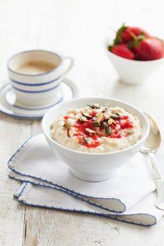Coconut, pumpkin seed and strawberry almond milk porridge. We suggest Unsweetened Vanilla Almond Breeze.