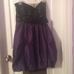 Formal Dress Only worn 1 time. Strapless sequin sweetheart neckline with zip up back & purple bottom with black flower on waist. B. Darlin Dresses