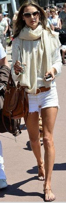 Who made Alessandra Ambrosio's white cut off denim shorts , brow handbag, and belt that she wore in Cannes?